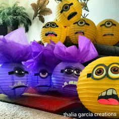 Minion lantern decorations I made from paper lanterns purchased at party city drew out eyes & mouths on paper plates with the ridges on the end  then with crayons & markers cut them out then hot glued them on to lanterns