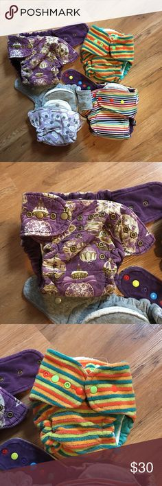 Cloth diaper bundle 3 OS (Christmas, purple cloud, rainbow stripe) 1 mini bum (orange and teal stripe) Other