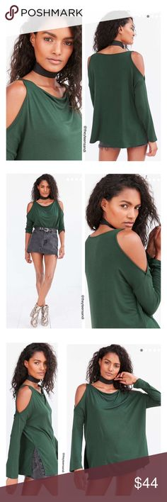 "Urban Outfitters Green Cold Shoulder Falun Top Light modern pullover sweatshirt in a drapey cold shoulder dolman-sleeve design by Silence + Noise. In soft baby French terry with edgy cut out shoulders, cut loose through the body with fitted long sleeves. Finished with a drapey cowl-neck and a side-slit hem. Purchased from Urban Outfitters.  Content + Care - Rayon, Spandex             - Machine wash - Imported      Size + Fit - Model is 5'11"" and wearing size Small  - Measurements taken from…"