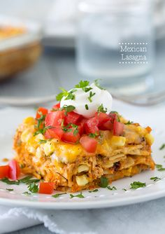 Mexican Lasagna - my entire family loved this kids included! It is soooo delicious! Corn tortillas are layered with a tex mex seasoned chicken, salsa and sour cream mixture and plenty of cheese of course.