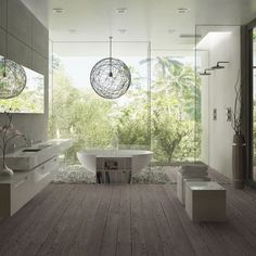 This bathroom design is very modern. The space under the vanity gives the room and very light and airy look. Also the large back window looking into nature gives the room an organic element.
