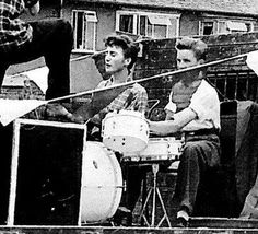 July 6, 1957, John Lennon met Paul McCartney for the first time at an outdoor church parish fete featuring John's skiffle group, The Quarrymen. Photo was taken that day 56 years ago, John at center.