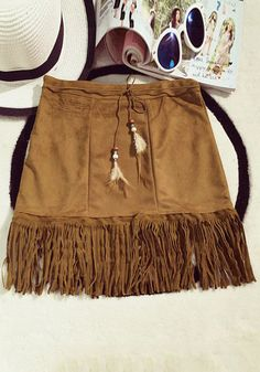 Complete your bohemian look inthis fringed brown suede skirt. It features a stylish mid-rise waist, a retro fringed hem, and cool feather tie straps. | Lookbook Store