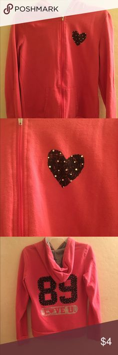 """Juniors hoodie Pink hoodie has black rhinestone heart on front and the number 89 in black with rhinestones on the back. Underneath says """"love u."""" With a rhinestone heart as the """"o"""". Gently worn, missing the drawstring and a couple rhinestones but still super cute! Hard Candy Tops Sweatshirts & Hoodies"""