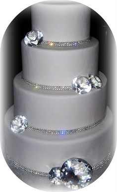 edible sugar diamonds - love the cake....not so sure about the HUGE diamonds at the bottom...