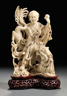 Ivory Carving, China, standing figure of a Luohan and a coiling dragon, on stand, (loss), ht. 10 1/2 in.