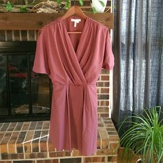 BCBG kimono style dress, maroon BCBG dress with kimono style sleeves. Fabric drapes in the front. Side pockets. Very cute over tights with heels. Fully lined. BCBGeneration Dresses Mini