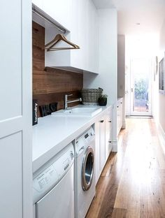 This whole house! Rachel and Marty's modern-classic Victorian cottage renovation:A narrow hallway leading to the backyard was turned into a practical yet pretty internal laundry. Laundry Nook, Laundry Room Organization, Laundry Storage, Laundry In Bathroom, Small Laundry, Laundry Cabinets, Wall Cabinets, White Cabinets, Hallway Cupboards