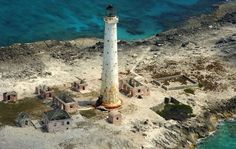 The lighthouse on Great Isaac Cay, a small island in the Bahamas around 20 miles north-east of the Bimini Islands, was built in 1859 to guide trade-ships carrying exports of sun-dried sea salt from Inagua, rum from Nassau, and aragonite lime-stone to markets in the US.  The lighthouse, though scoured by the sea and surrounded by the tumbledown buildings of the keeper's house, is actually still in operation as an unmanned light.