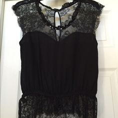 Express black silk and lace top Express black silk and lace top, black sequin around neck opening, elastic around bottom of shirt to accentuate the waist, small opening on upper back with button closure, excellent condition. Express Tops
