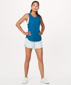 We designed this lightweight, relaxed fitting tank to provide breezy coverage for any and all of your sweaty endeavours. Mesh fabric paneling in the back helps keep you cool, while the high neckline and wide straps give you coverage where you want it most.