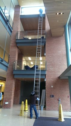 SLIPPERY when wet signs ? A slippy floor doesn't sound too gr8 a surface for a ladder support !!
