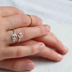 This great ring features a beautifully simple and delicate stem of tiny leaves on a fine adjustable band, which is flexible enough to be worn either as a midi or regular ring.  The ring is made of silver plated brass and can easily be stretched or squeezed to fit almost any finger