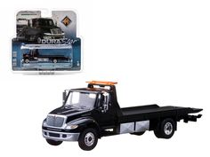 2013 International Durastar 4400 Flatbed Black Body Black Bed Tow Truck In Blister Pack 1/64 Diecast Model by Greenlight - Limited Edition. Detailed Interior, Exterior. Metal Body. Comes in a blister pack. Officially Licensed Product. Dimensions Approximately L-5.5 Inches Long.-Weight: 4. Height: 8. Width: 15. Box Weight: 4. Box Width: 15. Box Height: 8. Box Depth: 7