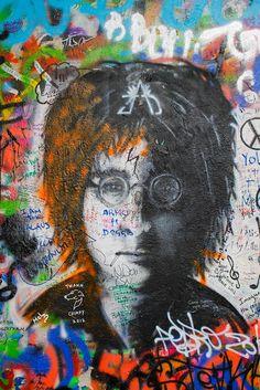 John Lennon grafitti art in a historic district of Prague, Czech Republic..