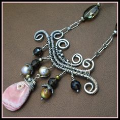 Great way to showcase a beautiful stone.  This is a rhodochrosite stone surrounded by smokey quarts and pearls.  Love it!
