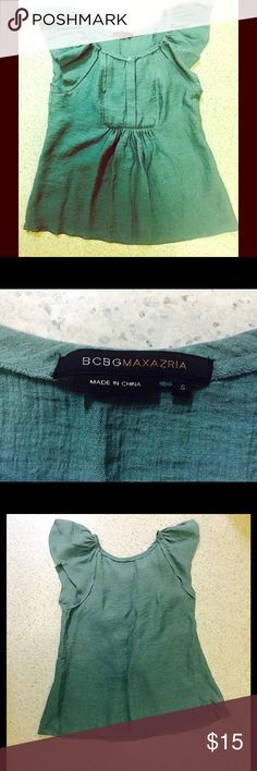 """BCBGMAXAZRIA Top Green BCBGMAXAZRIA Top Size Small.  Cute and flirty this top fits in almost anyone's wardrobe.  4 hidden buttons at bust which allows for you to show as much or as little as you'd like.  Approximately 24"""" long and 16"""" at bust.  77% Rayon 23% nylon.  ALL OFFERS ARE WELCOME! BCBGMaxAzria Tops Blouses"""