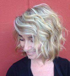 wavy messy blonde bob with bangs