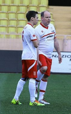 (R) Prince Albert of Monaco and his nephew Louis Ducruet during a football match in the Louis2 stadium of Monaco on 20.05.2014