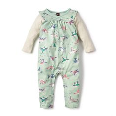 Pajaro Wrap Neck Romper | Pajaro is Spanish for bird. The brightly colored birds that fly and flutter all over this romper are inspired by illustrations on an old postcard from Argentina.