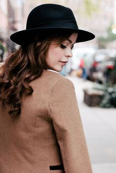 Taryn Manning...soft curls, black hat and humble demeanor