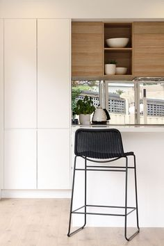 Nice example of a timber accent in a white kitchen