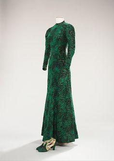 1937-1938 silk, metal, leather, and plastic Evening ensemble by Elsa Schiaparelli. Designer: André Perugia.