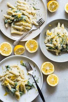 Penne pasta covered in a tangy goat cheese and rosemary sauce with spinach.