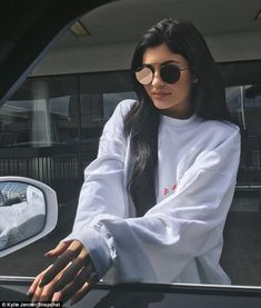 Ringing in rumours: Kylie first sparked engagement rumours when she shared an Instagram snap of herself sporting the ring while posing in front of her car a week ago