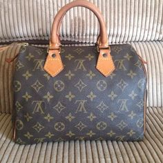 Authentic Louis Vuitton Speedy 25 Authentic Louis Vuitton Speedy 25 normal wear dark patina on handle no rips or tears good condition inside is perfectly clean Louis Vuitton Bags