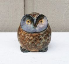 Hey, I found this really awesome Etsy listing at https://www.etsy.com/listing/294298793/small-brown-owl-ceramic-figurine