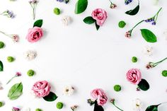 #Creative floral arrangement  Frame with roses pink flower buds branches and leaves on white background. Flat lay composition for bloggers magazines websites social media business owners and artists. This purchase includes one high resolution horizontal digital image. Image is a sRBG jpg and is approximately 3783x2521 pixels. Some more floral frame compositions here: http://ift.tt/29WABSO License terms: http://ift.tt/1W9AIer