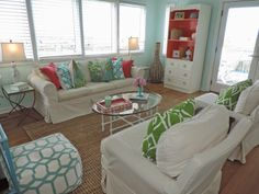 Aqua accent pillows from HomeGoods add punch to this slipcovered sofa in a Bald Head Island beach cottage.  #sponsored