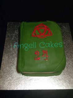 The book of shadows Cake by Angell Cakes