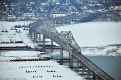 Aerial view of the sun setting over the frozen Hudson River and the Governor Malcolm Wilso...