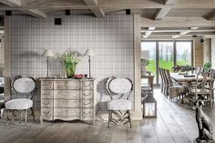 The gray, mixed in with the country chic French inspiration, executes an interior that's reminiscent of a beautiful, dreary day on the countryside. Decor Interior Design, Interior Decorating, Belgian Style, Outdoor Furniture Sets, Outdoor Decor, House In The Woods, Country Chic, Log Homes, Living Spaces