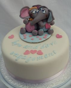 If the couple is more casual, we could do cuddle critters instead of fondant people, too. Elephants, teddy bears, frogs, you name it.