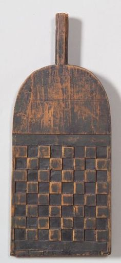 """Carved and Painted Checkers GameBoard Paddle, America, 19th century, paddle form game board with integral handle, stippled inscription on the arch reads """"J 1838 B,"""" carved checked playing field, painted black, 15 1/2 x 6 1/2 in."""