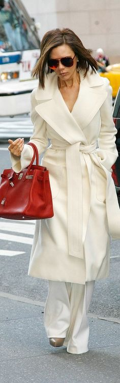 White coat with white pants and handbag
