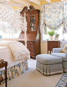 Rustic bedroom receives glam treatment with blue and white gingham chair and toile window treatments.