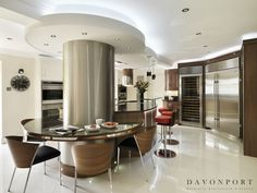 Stainless steel appliances and the stainless steel central column become part of the colour scheme. Kitchen Colour Schemes, Color Schemes, Bespoke Kitchens, Stainless Steel Appliances, Contemporary Style, Kitchen Design, Design Ideas, Traditional, Table