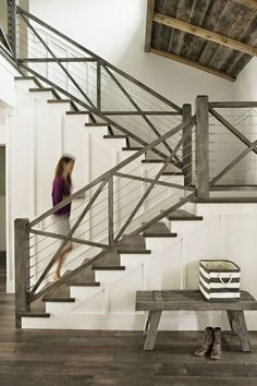 Gray distressed wood for flooring and stair railing, x-railing style with wire cables, modern wire and wood stair railing, board and batten wall for stairway