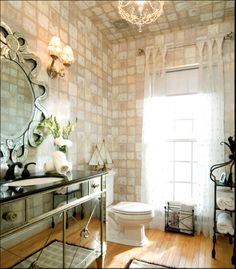 Fully tiled golden nuetral walls and glam vanity