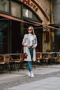 The fail proof outfit formula for spring 2017: trench coat, step hem jeans & ruffled shirt