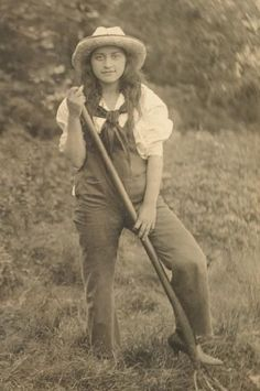 farm girl ... great old photo ... she's wearing overalls and heels ...