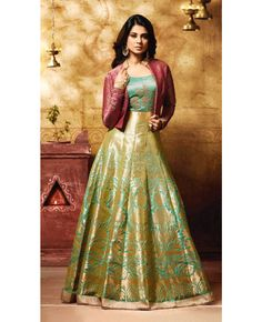 Give in to the exotic confluence of today and tomorrow in this beautiful attire. Include yourself in the glamour of the season with this Jennifer Winget green banarasi silk floor length anarkali suit. The zari, lace and embroidered work on attire personifies the entire appearance. Comes with matching bottom and dupatta