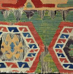 Early green ground Konya kilim fragment