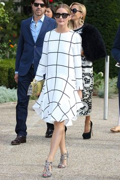 "When [link url=""http://www.glamourmagazine.co.uk/olivia-palermo""]Olivia Palermo[/link] stepped out wearing this black and white checked dress from Chloe, the fash pack swooned. A lesson to take away from this look? Get shopping for a loose check dress, and stat! Is there a high-street inspired version out yet?"