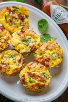 Breakfast casserole muffins come together quickly. Loaded with potato, spinach, eggs, cheese and crisp bacon. Freezer friendly make-ahead breakfast muffins!