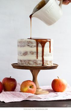 A light apple cake is paired with goat cheese frosting and salted caramel drizzle. A cake recipe to celebrate fall baking, apple season, Thanksgiving and more.